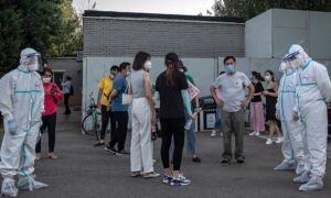Medical Staff Across China Dispatched to Beijing as Neighborhoods, Restaurants Hit Hard by Virus