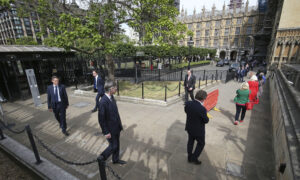 UK Lawmakers Line Up to Vote as Parliament Adjusts to COVID-19